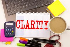 Word writing Clarity in the office with  laptop, marker, pen, stationery, coffee. Business concept for Clarity Message Workshop wh. Ite background with space Stock Photo