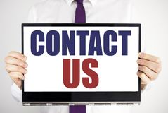Word, writing Contact Us. Business concept for Customer Support Written on tablet laptop holding by the man blurred background. Bu. Word, writing Contact Us royalty free stock photos