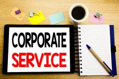 Word, writing Corporate Service. Business concept for Csr Digital Content Written on tablet laptop, wooden background with sticky. Word, writing Corporate Royalty Free Stock Images