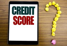 Word, writing Credit Score. Business concept for Financial Rating Record Written on tablet, wooden background with question mark o. Word, writing Credit Score royalty free stock images
