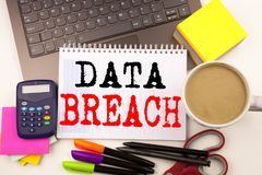 Word writing Data Breach in the office with surroundings such as laptop marker pen stationery coffee Business concept for Tech Int Stock Photos