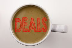 Word, writing Deals text in coffee in cup. Business concept for Advertising Deal on white background with copy space. Black text w. Word, writing Deals text in royalty free stock photography