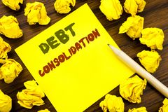 Word, writing Debt Consolidation. Business concept for Money Loan Credit Written on sticky note paper, wooden background with fold. Word, writing Debt Royalty Free Stock Image