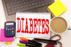 Word writing Diabetes in the office with laptop, marker, pen, stationery, coffee. Business concept for Disease Medical Insulin Wor. Kshop white background with Royalty Free Stock Photos