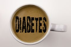 Word, writing Diabetes text in coffee in cup. Business concept for Disease Medical Insulin on white background with copy space. Black text Stock Photos
