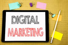 Word, writing Digital Marketing. Business concept for internet, online, Written on tablet laptop, wooden background with sticky no. Word, writing Digital Stock Image