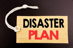 Word, writing Disaster Plan. Business concept for online sale Emergency Recovery written on price tag paper on the black vintage b. Word, writing Disaster Plan Royalty Free Stock Photos