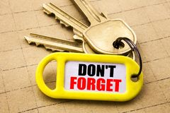 Word, writing Do Not Forget. Business concept for Don t memory Remider Written on key holder, textured background close up. Word, writing Do Not Forget Royalty Free Stock Photography