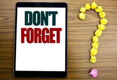Word, writing Do Not Forget. Business concept for Don t memory Remider Written on tablet, wooden background with question mark on. Word, writing Do Not Forget Stock Photo