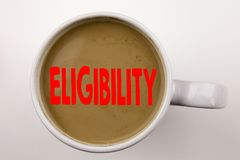 Word, writing Eligibility text in coffee in cup. Business concept for Suitable Eligible Eligibility on white background with copy. Word, writing Eligibility text Royalty Free Stock Photos