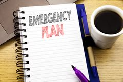 Word, writing Emergency Plan. Business concept for Disaster Protection written on notebook book on the wooden background in the Of. Word, writing Emergency Plan Stock Images