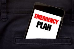 Word, writing Emergency Plan. Business concept for Disaster Protection Written phone mobile phone, cellphone placed in the man fro. Word, writing Emergency Plan stock photos