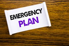 Word, writing Emergency Plan. Business concept for Disaster Protection written on sticky note paper on the wooden wood structure v. Word, writing Emergency Plan Stock Photo