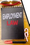 Word, writing Employment Law. Business concept for Employee Legal Justice Written on the notebook book, wooden background with sti. Word, writing Employment Law Royalty Free Stock Photography