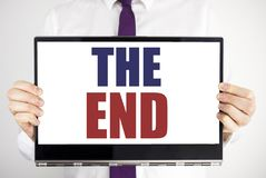 Word, writing The End. Business concept for End Finish Close Written on tablet laptop holding by the man blurred background. Busin stock image