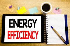 Word, writing Energy Efficiency. Business concept for Electricity Ecology Written on tablet laptop, wooden background with sticky. Word, writing Energy royalty free stock image