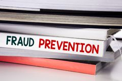 Word, writing Fraud Prevention. Business concept for Crime Protection written on the book on the white background. Word, writing Fraud Prevention. Business Stock Photos