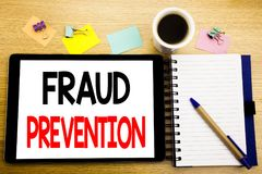 Word, writing Fraud Prevention. Business concept for Crime Protection Written on tablet laptop, wooden background with sticky note. Word, writing Fraud Stock Images
