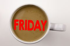 Word, writing Friday text in coffee in cup. Business concept for Friday - happy end of the week on white background with copy spac. Word, writing Friday text in Stock Photo