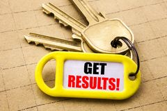 Word, writing Get Results. Business concept for Achieve Result Written on key holder, textured background close up. Word, writing Get Results. Business concept Royalty Free Stock Photos