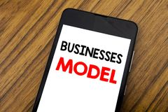 Word, writing handwriting Businesses Model. Business concept for Project For Business Written on mobile phone cellphone, wooden ba. Word, writing handwriting royalty free stock photo
