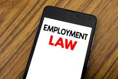 Word, writing handwriting Employment Law. Business concept for Employee Legal Justice Written on mobile phone cellphone, wooden ba. Word, writing handwriting Royalty Free Stock Images
