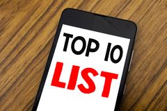 Word, writing handwriting Top 10 Ten List. Business concept for Success ten list Written on mobile phone cellphone, wooden backgro Royalty Free Stock Image