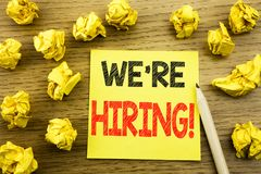 Word, writing We Are Hiring Now. Business concept for Recruitment Human Resources written on sticky note paper on the wooden back. Word, writing We Are Hiring stock photography