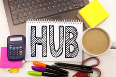 Word writing HUB in the office with laptop, marker, pen, stationery, coffee. Business concept for HUB Advertisement Workshop white. Background with space Royalty Free Stock Images