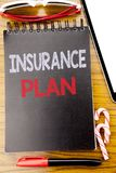 Word, writing Insurance Plan. Business concept for Health Life Insured Written on the notebook book, wooden background with sticky. Word, writing Insurance Plan Royalty Free Stock Photos