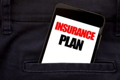 Word, writing Insurance Plan. Business concept for Health Life Insured Written phone mobile phone, cellphone placed in the man fro. Word, writing Insurance Plan stock images