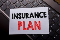 Word, writing Insurance Plan. Business concept for Health Life Insured written on sticky note paper on the dark keyboard backgroun. Word, writing Insurance Plan Royalty Free Stock Images