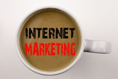 Word, writing Internet Marketing text in coffee in cup. Business concept for Technology Strategy Design on white background with c Royalty Free Stock Images