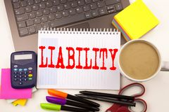 Word writing Liability in the office with  laptop, marker, pen, stationery, coffee. Business concept for Accountability Legal Blam. E Risk Workshop white Royalty Free Stock Images