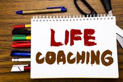 Word, writing Life Coaching. Business concept for Personal Coach Help Written on notebook, wooden background with office equipment. Word, writing Life Coaching Royalty Free Stock Image