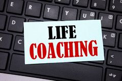 Word, writing Life Coaching. Business concept for Personal Coach Help written on sticky note paper on the black keyboard backgroun. Word, writing Life Coaching Stock Image