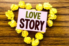 Word, writing Love Story. Business concept for Loving Someone Heart  written on sticky note paper on the wooden background. Word, writing Love Story. Business Stock Photo