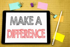 Word, writing Make A Difference. Business concept for Motivation Success Written on tablet laptop, wooden background with sticky n stock photos