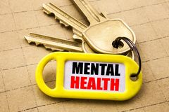 Word, writing Mental Health. Business concept for Anxiety Illness Disorder Written on key holder, textured background close up. Word, writing Mental Health royalty free stock images