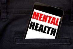 Word, writing Mental Health. Business concept for Anxiety Illness Disorder Written phone mobile phone, cellphone placed in the man. Word, writing Mental Health royalty free stock photography