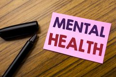 Word, writing Mental Health. Business concept for Anxiety Illness Disorder Written on sticky note red paper, wooden background wit. Word, writing Mental Health royalty free stock image