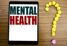 Word, writing Mental Health. Business concept for Anxiety Illness Disorder Written on tablet, wooden background with question mark. Word, writing Mental Health royalty free stock image