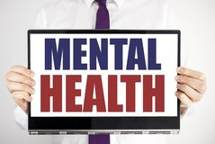 Word, writing Mental Health. Business concept for Anxiety Illness Disorder Written on tablet laptop holding by the man blurred bac. Word, writing Mental Health stock photos