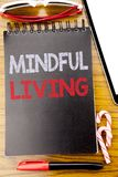 Word, writing Mindful Living. Business concept for Life Happy Awareness Written on the notebook book, wooden background with stick. Word, writing Mindful Living Royalty Free Stock Image