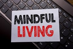 Word, writing Mindful Living. Business concept for Life Happy Awareness written on sticky note paper on the dark keyboard backgrou. Word, writing Mindful Living Stock Photos