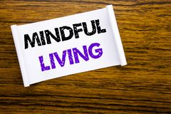 Word, writing Mindful Living. Business concept for Life Happy Awareness written on sticky note paper on the wooden wood structure. Word, writing Mindful Living Royalty Free Stock Photos