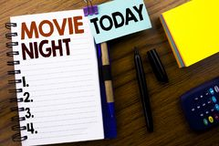 Word, writing Movie Night. Business concept for Wathing Movies written on book note paper on the wooden background. With attached. Word, writing Movie Night royalty free stock image