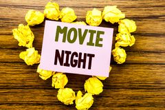 Word, writing Movie Night. Business concept for Wathing Movies written on sticky note paper on the wooden background. Word, writing Movie Night. Business stock images