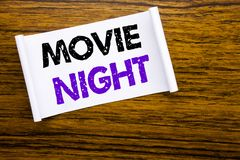 Word, writing Movie Night. Business concept for Wathing Movies written on sticky note paper on the wooden wood structure visible. Word, writing Movie Night royalty free stock images