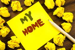 Word, writing My Home. Business concept for House Estate Love Written on sticky note paper, wooden background with folded yellow p stock photography